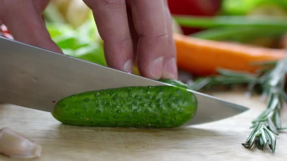 Thumbnail for Close Up of Hands of Male Cook Cutting Fresh Cucumber