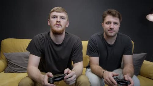 Homosexual Male Couple Plays Xbox