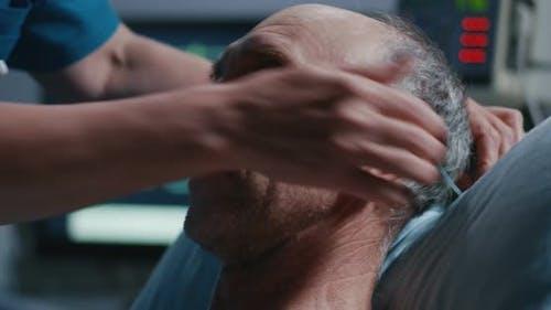 Nurse Placing Nasal Cannula Into Patients Nose