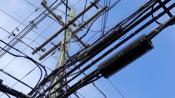 Thumbnail for A Utility Pole Covered in Cables