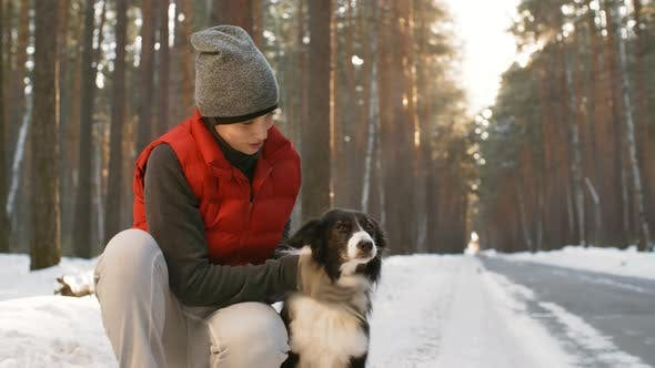 Thumbnail for Portrait of Woman Stroking Border Collie