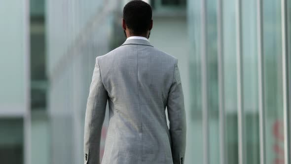 Thumbnail for Back View of Confident Businessman Wearing Suit Walking on Street