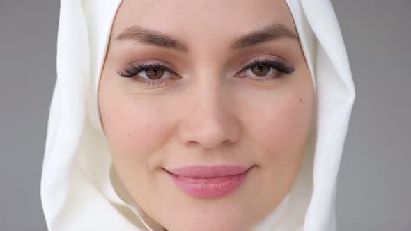 Closeup Face of Muslim Woman Wearing Hijab is Looking at Camera and Smiling