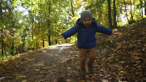 Thumbnail for Portrait of Cheerful Toddler Boy Running in Park