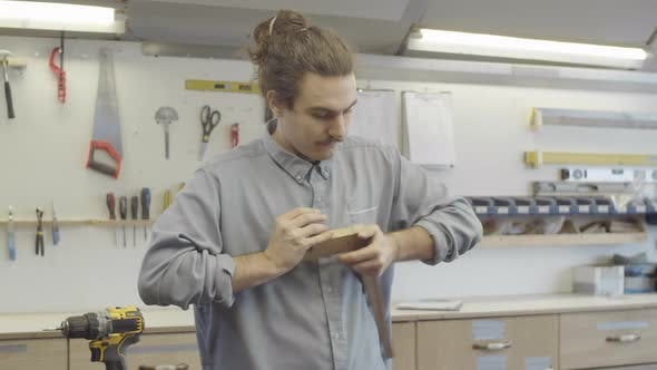 Thumbnail for Young Carpenter Joining Together Furniture Components at Workshop