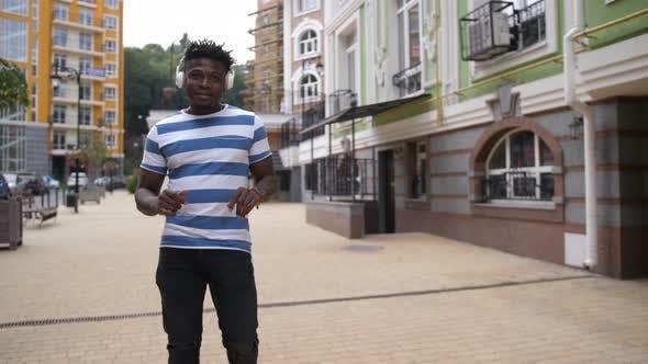 Thumbnail for Joyful Black Man Enjoying Music on City Street