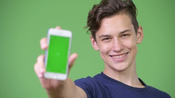 Thumbnail for Young Handsome Teenage Boy Showing Phone