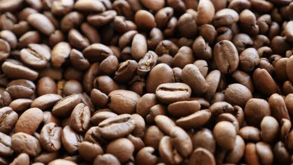 Thumbnail for Fresh roasted arabica coffee beans on table slow tilt 4K 2160p 30fps UHD video - Slow tilting over a