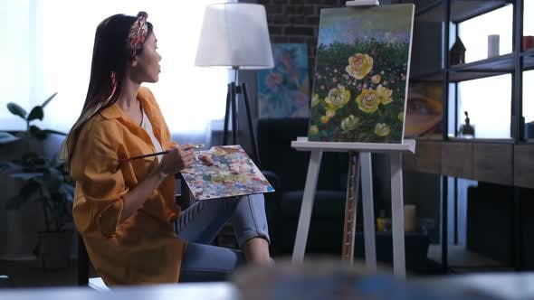 Thumbnail for Young Female Artist Admiring Her Finished Painting