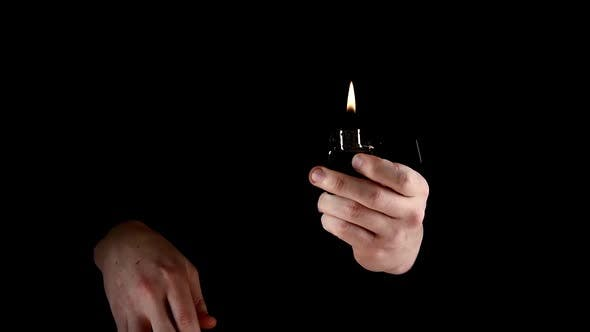 Thumbnail for Magician Fire Show - Kindle Lighter, on Black, Slow Motion