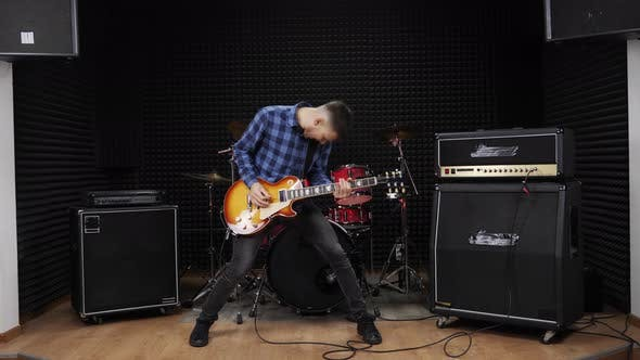 Guitar player is rocking fans on live concert