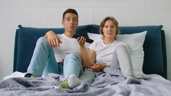 Thumbnail for Young Mixed Race Couple Is Looking for Something To Watch on TV