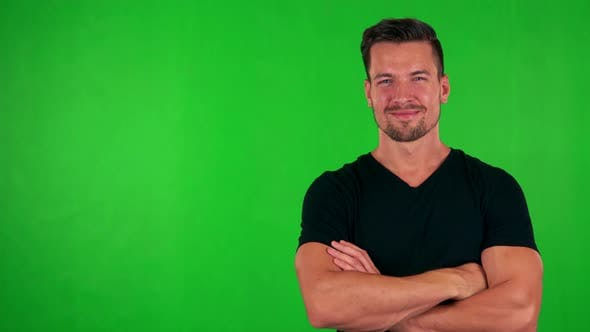 Thumbnail for Young Handsome Caucasian Man Smiles To Camera with Folded Arms - Green Screen