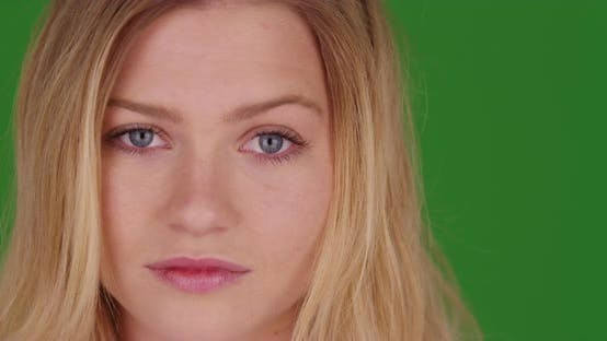 Thumbnail for Close up portrait of beautiful millennial blonde woman smiling on green screen