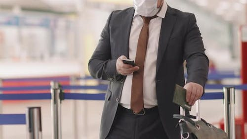 Businessman With Suitcase At Check-In