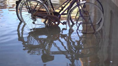 Bicycles Parked in the City Flooded By the Tsunami
