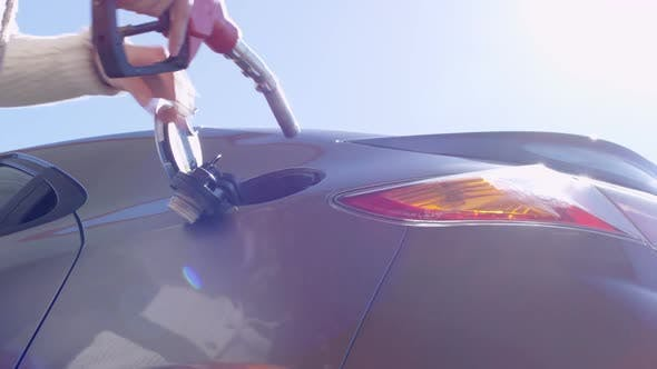 Thumbnail for Male Hands Putting Nozzle into Car Tank