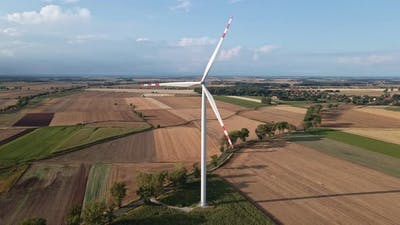 Windmill Turbine in the Field at Summer Day