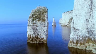 Close Fly by of Chalk Cliffs in England