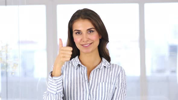 Thumbnail for Portrait of Hispanic Woman Gesturing Thumbs Up