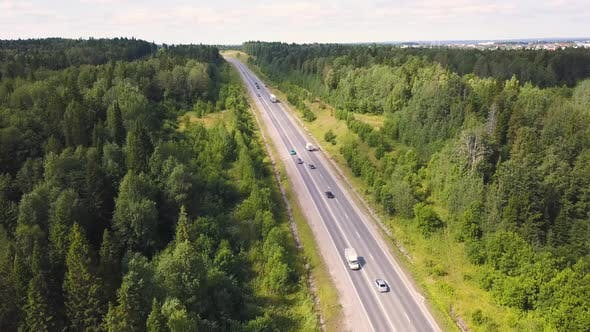 Thumbnail for Aerial View Of Car Driving Through The Forest On Country Road