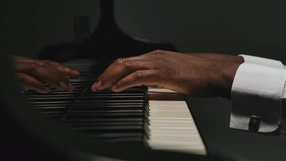 Thumbnail for Footage of Male Hands Playing the Grand Piano. An African American Man Touches His Fingers on the