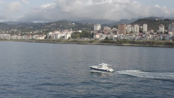 Thumbnail for Trabzon City Mountains Sea And Following Speed Boat Aerial View