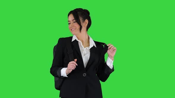 Thumbnail for Beautiful Girl with a Backpack Dancing on a Green Screen, Chroma Key