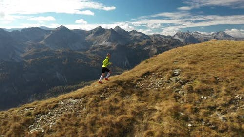 Aerial View Man Trail Running on Ridge in Mountains