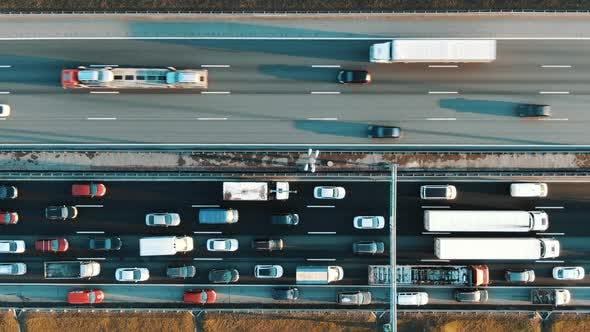 Thumbnail for Cars Casting Shadows Move Along Lane with Light Asphalt