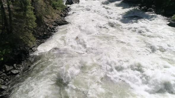 Thumbnail for Amazing Aerial Of Extreme Pro Kayaker Charging Dangerous Massive Waves Of Wild White Water River