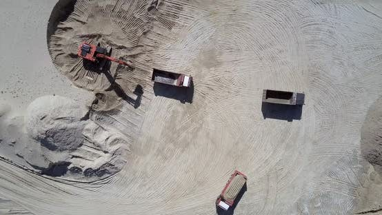 Excavator Fills Tipper with Ore at Sand Quarry Aerial View