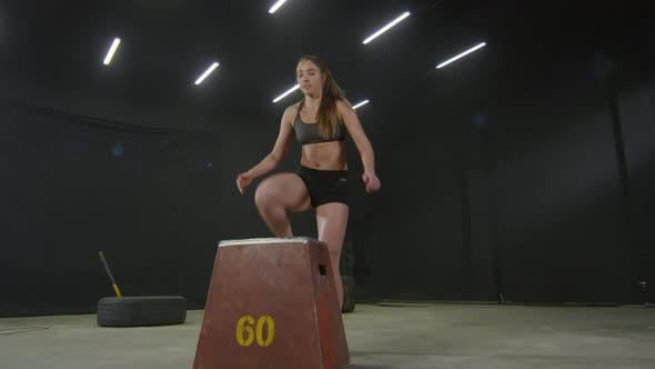 Cover Image for Determined Woman Doing Jump Workout