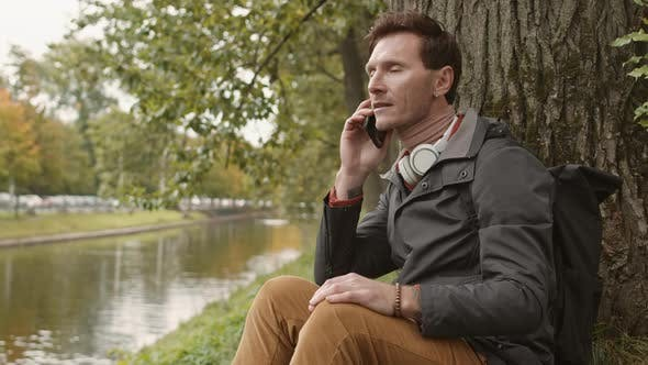 Thumbnail for Man Talking on Phone on Lawn