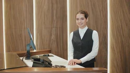 Portrait of Woman at Reception Desk