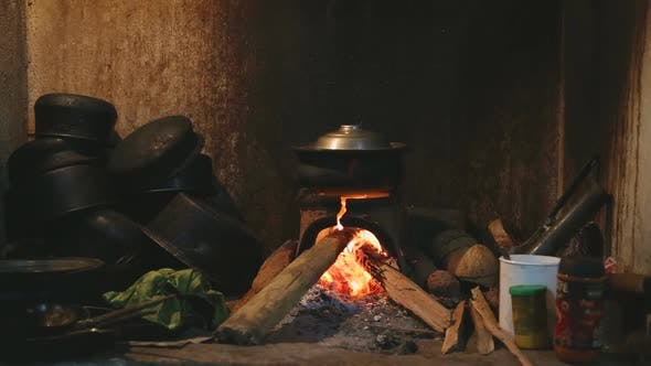 Thumbnail for View burning fire heating a pot for cooking in local kitchen in Sri Lanka