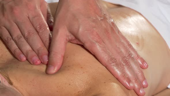 Thumbnail for Hands of Professional Masseur Sliding on the Shoulder of Female Client