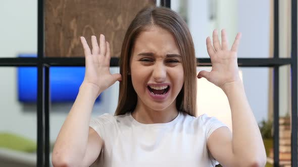 Cover Image for Portrait of Screaming Upset Young Girl