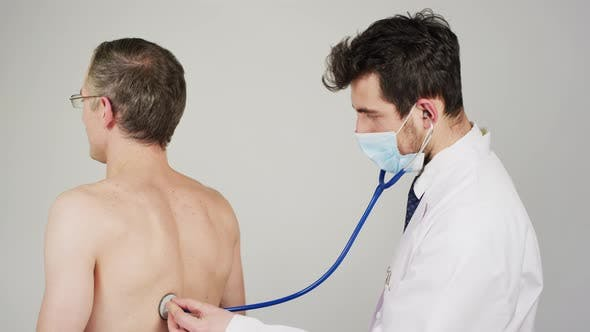 Cover Image for Listening to patient's breathing with stethoscope