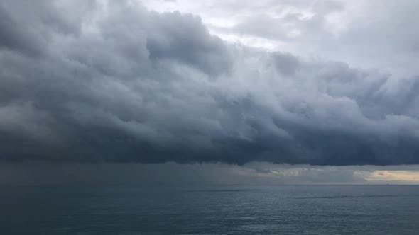 Heavy Rain Clouds Above Sea Timelapse