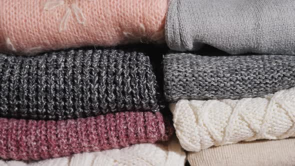 Slider Video: Neatly Folded Winter Clothes