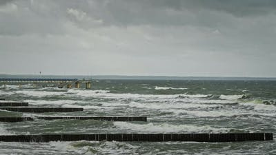 Rough Sea Waves Crashing Near Pier