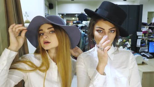 Girls trying on hats