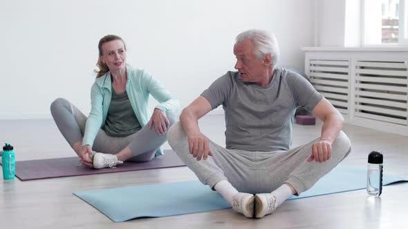 Pair of Seniors Exercising