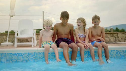 Kids Dipping By the Pool