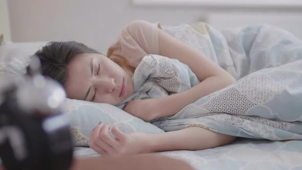 Thumbnail for Asian Woman Sleeping in Her Bedroom