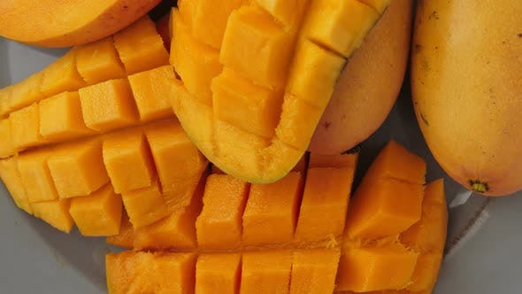 Thumbnail for Yellow Ripe Cut Mango on Plate