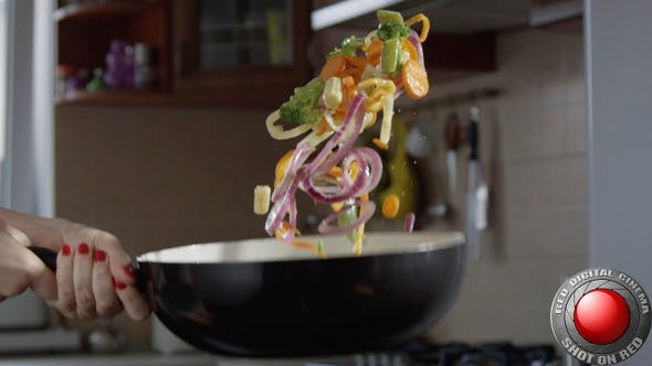 Thumbnail for Cooking Vegetables On A Frying Pan Throwing Food In Slow Motion In The KitchenShot On Red Camera
