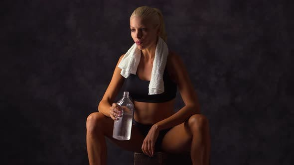 Thumbnail for Woman athlete drinking water