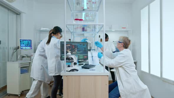 Thumbnail for Multiethnic Team Working in Busy Laboratory